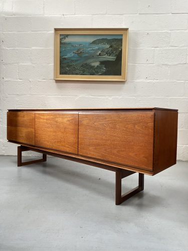 A fantastic linear teak sideboard designed by Philip Hussey for White & Newton of Portsmouth, circa 1967.